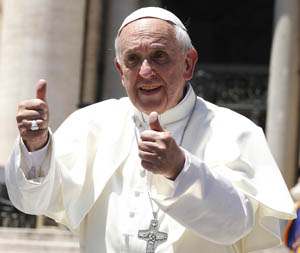 Pope gives two thumbs up as he leaves general audience at Vatican